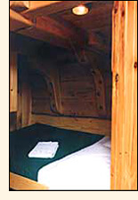 Cabin with a double bed.
