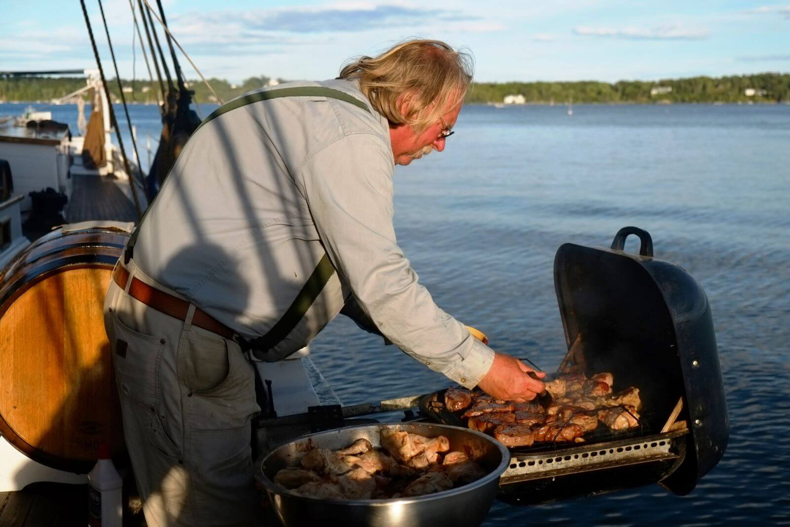 Captain Ray cooking steaks Schooner Grace Bailey