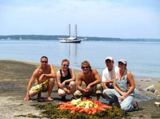 Casey, Tatyana, Justin, Capt. JR Braugh and Kristi Williamson present a lobster bake that they prepared for their passengers. (Photo by David Helms)...
